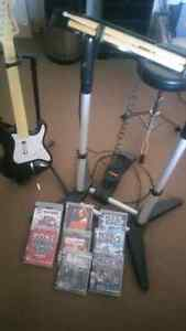 PS3 Rockband drums and guitar. 8 Rockband games