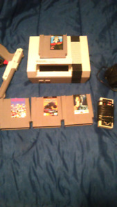 Nes console with control and 4 games