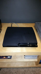 Sony PS3 ---4 Controllers, Wireless Keypad and 25 Games