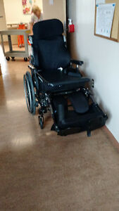 WHEEL CHAIR WITH HEAD REST AND TABLE ,FOOT RESTS CAN HAVE A BATT