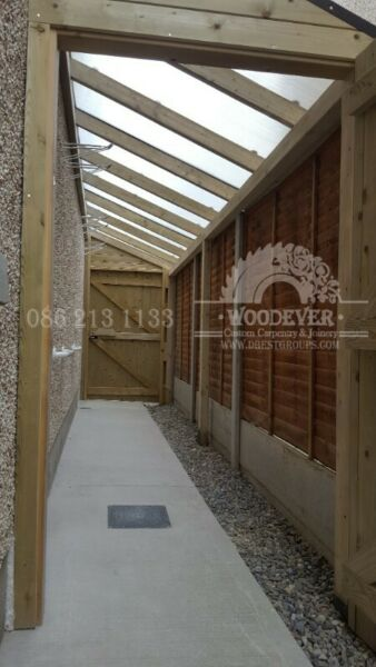 Side entrance passageway with roof, rain shelter, safe, secure bike or toy storage at side of house