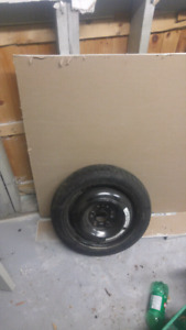 Honda civic spare tire with rim never used.