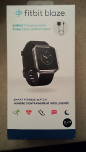 new in the box Fitbit blaze with bonus charger