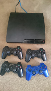 PS3 with 4 controllers and 39 games