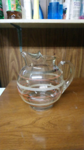 Vintage glass pitcher with colour lines in it