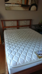 SOLD. Double bed with pillow top mattress