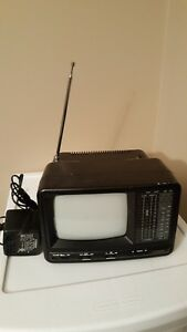 PORTABLE BLACK AND WHITE T.V WITH AM/FM RADIO