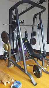 Smith machine with bench and weights.