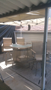 Patio bar height table and chairs $265..