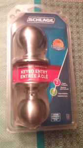 Schlage Orbit knob brass keyed entry door lock.Brand new packed