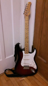 Electric guitar with case + amplifier and accesories