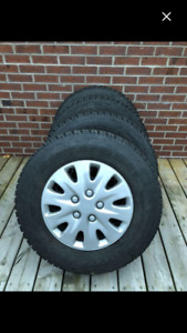 Toyo G-02 Plus Open Country winter tires on rims x4