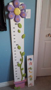 Children's growth chart and wall rack