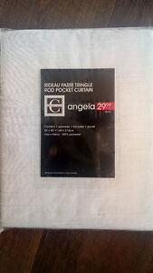 4 white curtain panels (Still in package)