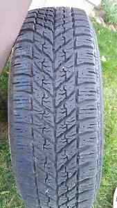 Good Year Ultra Grip Winter Tires 235/65/R16 103T On Rims
