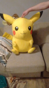 A Pokemon of a Pikachu stuffed animal in good condition
