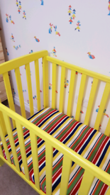Yellow wooden cot bed