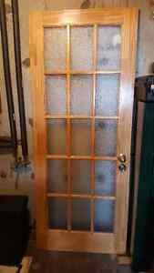 Two doors with multiple glass inserts