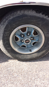 Olds cutlass rims with useable tires.