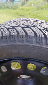 STUDDED WINTER TIRES AND RIMS FORD FOCUS LIKE NEW!