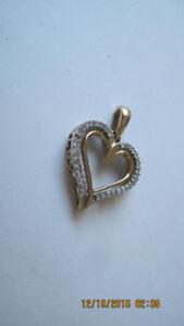 Ladies 10k yellow gold/diamonds heart pendants