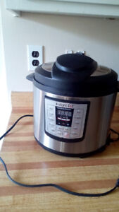 Instant Pot Programmable Electric Cooker: $100 OBO
