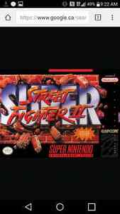 Looking for super street fighter 2 or ultimate MK 3 for SNES Cornwall Ontario image 1