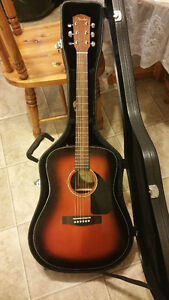 Brand new acoustic guitar with hard case and accord device(250$)