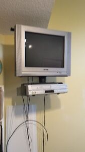 TV, wall mounted stand and VCR/ DVD player