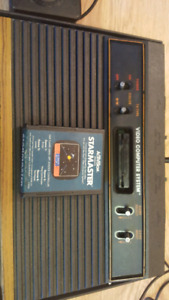 Classic Atari 2600 with controllers and game