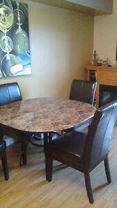 Heavy glass table 4 leather chairs