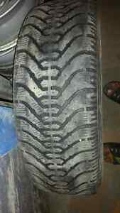 215 70 R15 Tires. 1 winter 1 summer tire with 75% tread