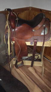 Western Saddle with reins halter buck strap and stand