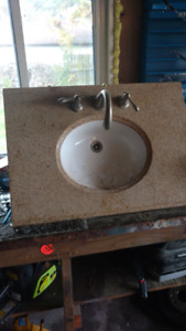 Granite sink with taps