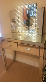 Mirrored bedside and dressing table with vanity mirror.