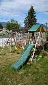 Used wooden outdoor play set