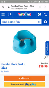 Blue bumbo seat with safety strap and tray