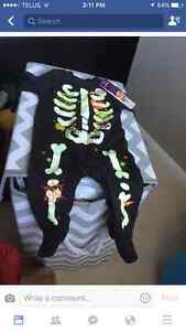 Brand new with tags, UK glow in the dark halloween onesie
