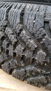 Brand new Goodyear Nordic P215/70R15 snow tires on aluminum rims