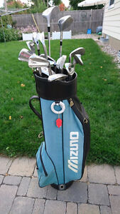 Golf clubs (right handed), bag and pull carts