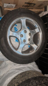 HAVE 4 MUSTANG RIMS WITH TIRES FOR SALE