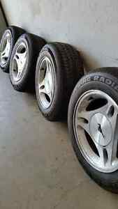 Set of Ford alloy wheels and good 'Summer' tires..