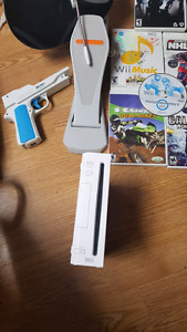 Wii for sale. Rockband and games included