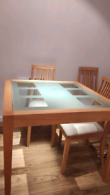 Solid glass top wooden dining table for sale