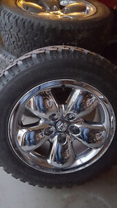 Factory Ram 1500 20 inch rims with BFG All Terrain T/A tires