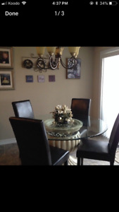 Elegant glass dining table with (4) faux leather chairs