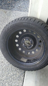 1 like new snow tire 205-55-16 WITH SNOW FLAKE on 5 bolt rim
