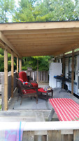Deck with new shingled roof