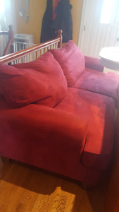 Red couch and big comfy chair