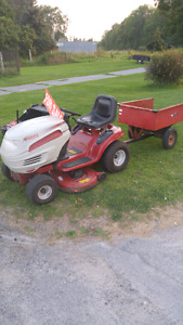 2007 white lawn tractor with toro trailer